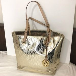df3d62c5d9db Michael Kors. Michael Kors Jet Set Mirror Gold Metallic Tote